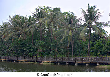 Beautiful wooden bridge across river