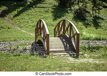 Beautiful wooden bridge in spring Park in Sunny day