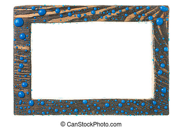 Beautiful wooden frame in drops of blue paint. Isolated on white background.