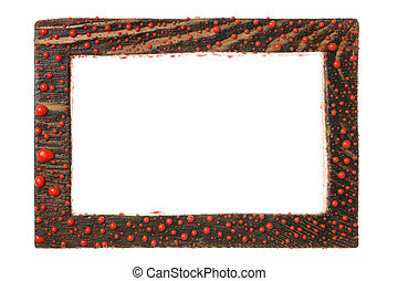 Beautiful wooden frame in drops of red paint. Isolated on white background.