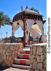 Beautiful wooden gazebo in the Egyptian hotel