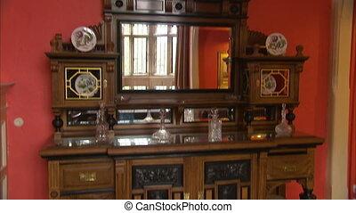 Beautiful wooden shelf with a mirror - A tilt down shot of...