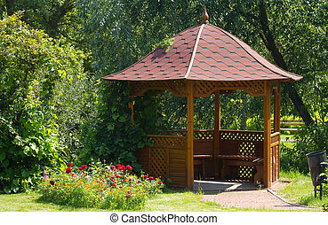 Beautiful wooden summerhouse and flowers