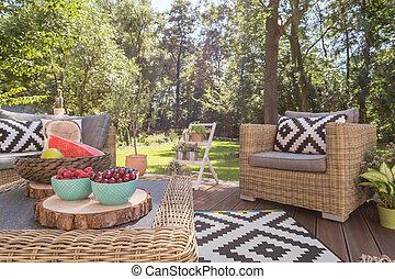 Beautiful wooden terrace in the garden