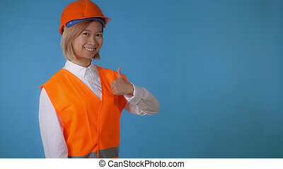 beautiful worker in uniform shows sign like