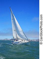 Beautiful yacht in San Francisco bay, city on the horizon. California, USA