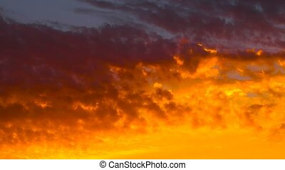 Beautiful yellow and orange cloudscape time lapse footage of sunset