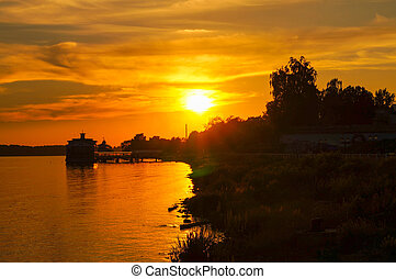 beautiful yellow and orange sunset on the river