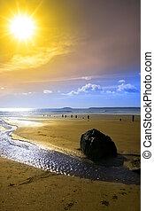 Beautiful yellow sun over the Youghal beach