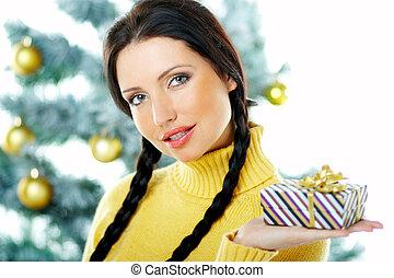 Beautiful Yellow Xmas - Beautiful brunette woman next to ...