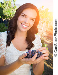 Beautiful Young Adult Woman Enjoying A Walk In The Grape Vineyard