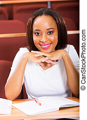 young african american girl sitting in classroom