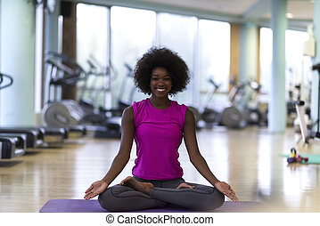 african american woman exercise yoga in gym - beautiful...