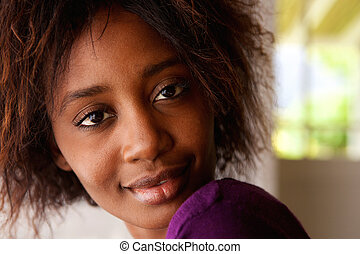 Beautiful young african american woman looking at camera