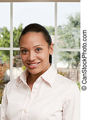 Beautiful young african american woman smiling