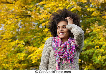 Beautiful young african american woman smiling with hand in hair