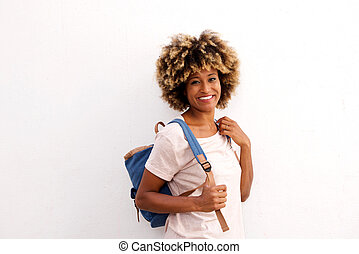 Beautiful young african american woman standing against white background