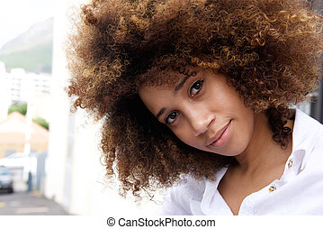 Beautiful young african american woman with afro