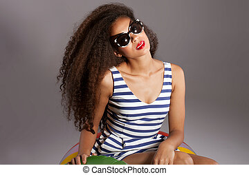 Beautiful young african american woman with long healthy hair