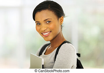 young african college girl holding laptop