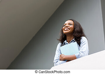 young african college girl looking up