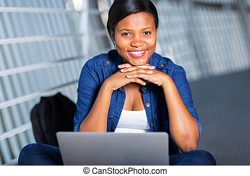young african college student with laptop