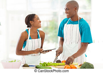 young african couple in home kitchen