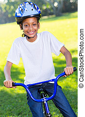 young african girl riding a bike