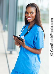 young african nurse holding tablet computer