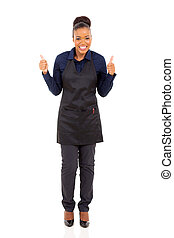 young african waitress with thumbs up
