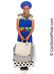 young african woman carrying shopping bags