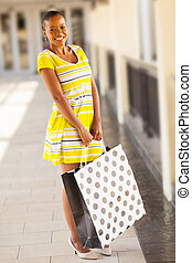 young african woman in shopping center