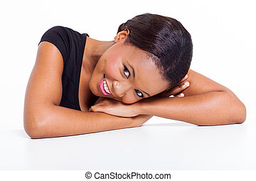 young african woman laying on a desk