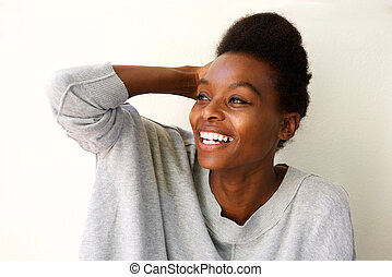Beautiful young african woman looking away and smiling