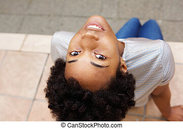 Beautiful young african woman looking up