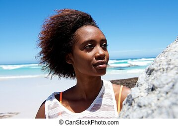 Beautiful young african woman outdoors at the beach