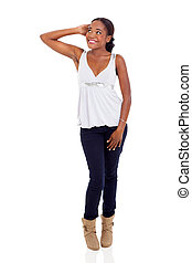 young african woman posing over white background