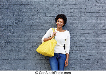 Beautiful young african woman with handbag