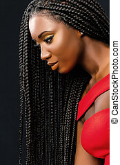 Beautiful young african woman with long braided hair.
