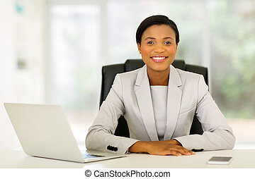 young afro american businesswoman relaxing in office