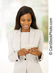 young afro american career woman using cell phone