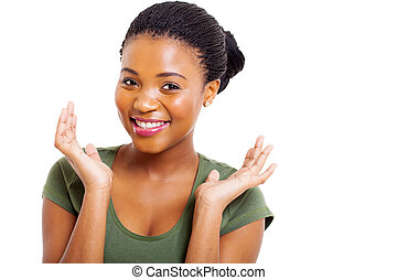 beautiful young afro american woman posing over white background