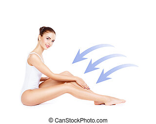 Beautiful, young and sporty woman with arrows isolated on white. Health, sport, fitness, nutrition, weight loss, diet, cellulite removal, liposuction, healthy life-style concept.