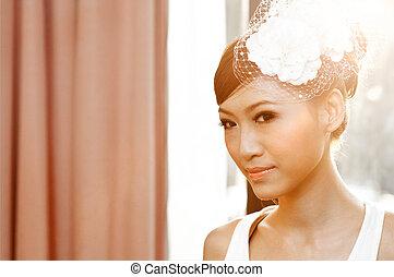 Beautiful young Asian bride smiling