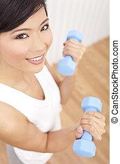 Beautiful Young Asian Chinese Woman Lifting Weights At Gym
