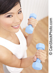 Beautiful Young Asian Chinese Woman Lifting Weights At Gym