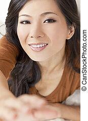 Beautiful Young Asian Chinese Woman Reaching To Camera