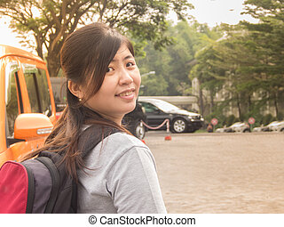 Beautiful Young Asian - Chinese Woman Smiling Going to Travel