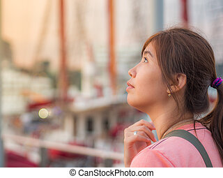 Beautiful Young Asian - Chinese Woman Thinking in Harbor