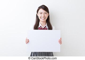school girl - Beautiful young asian school girl holding...